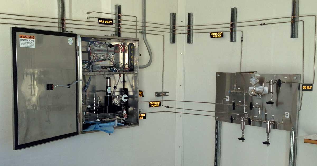 Inside a fiberglass building with odorization equipment